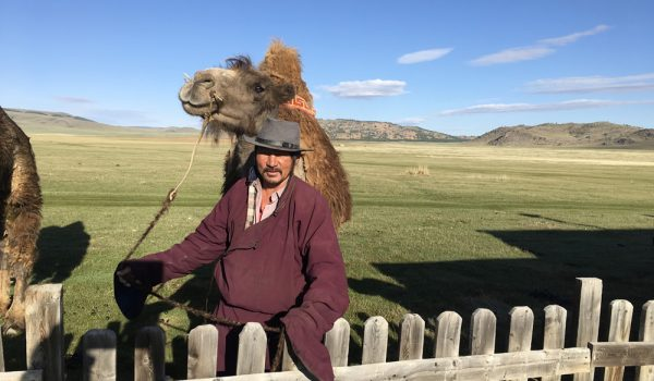 Mongolian nomad and camel Overland Journeys Mongolia tour