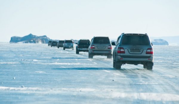 Landcruiser convoy on frozen lake BAM ice road